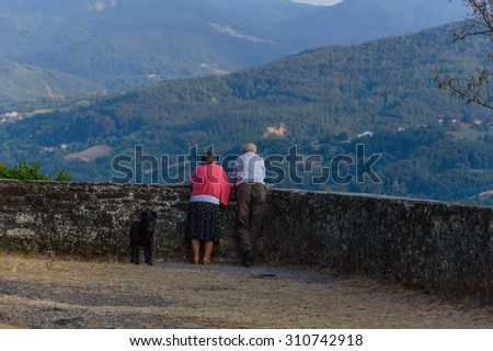 Old couple with their dog  - stock photo