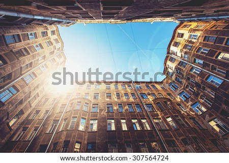 Old Courtyard In St. Petersburg. Bottom View To Vintage Old Buildings. Soft Color Effect - stock photo