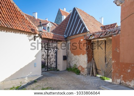 Old courtyard in Tallinn with small houses and gates