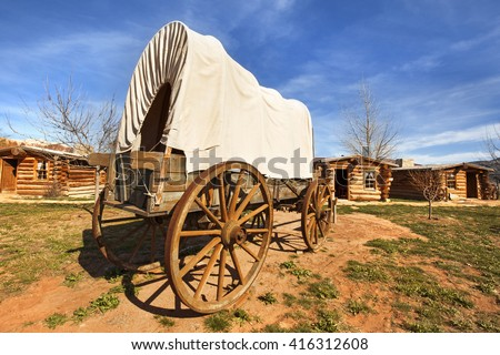 old covered wagon in a pioneers' village - stock photo