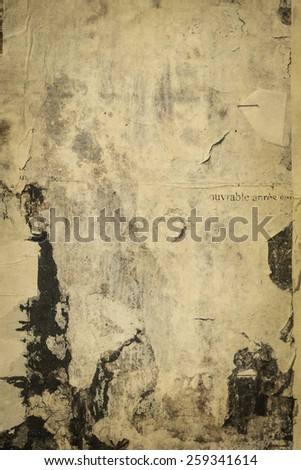 old cracked bulletin board wall with rests of paper - stock photo