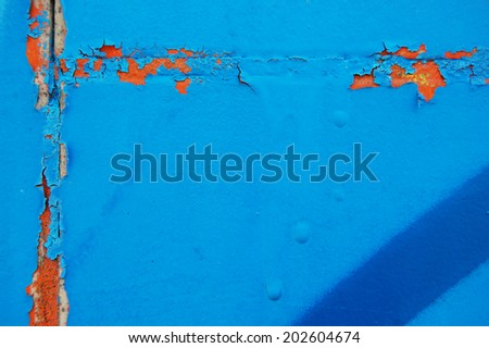Old cracked paint pattern on concrete background. Peeling paint. Pattern of grunge material. Damaged paint - stock photo