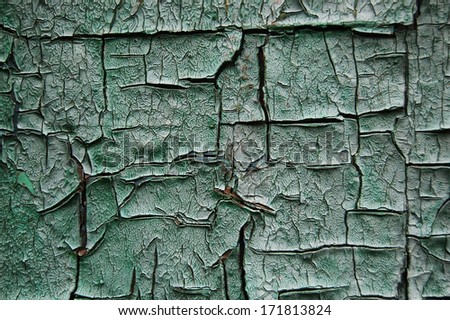 Old cracked paint pattern on rusty background. Peeling paint. Pattern of light-green grunge material. Damaged paint. Scratched old plate - stock photo