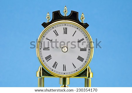 old cracked used ornamental clock face dial on blue background - stock photo