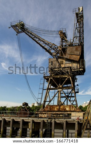 Old crane port on the River Thames in London, England