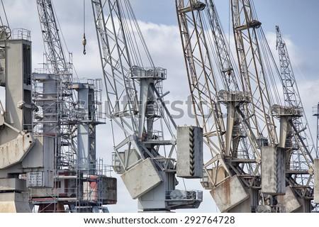 Old cranes in the harbor of Hamburg, Germany - stock photo