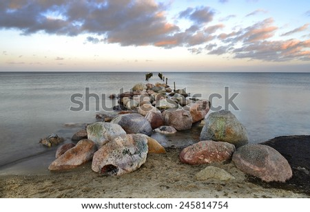 Old crashed pier in the Baltic Sea, Latvia - stock photo