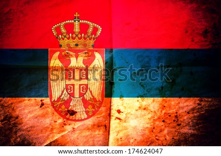 Old creased paper with Serbian flag as the background