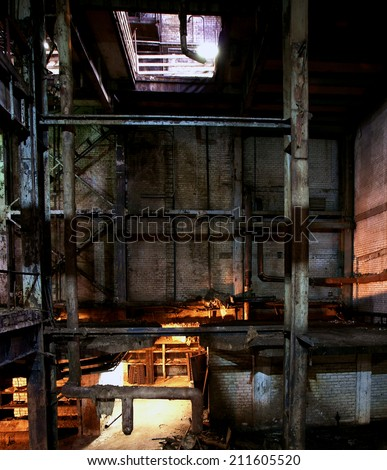 Old creepy, dark, decaying, destructive, dirty factory - stock photo