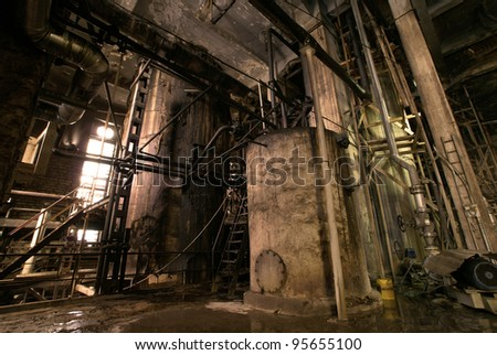 old creepy dark decaying dirty factory - stock photo