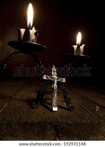 Old Cross and Candles on Wooden Background. - stock photo