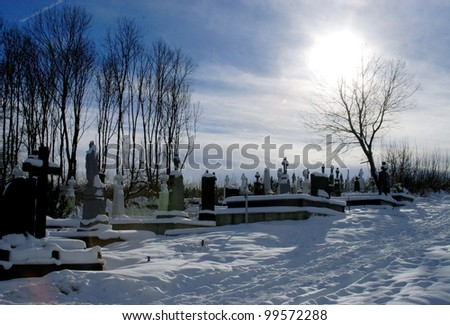 old cross in the old cemetery - stock photo