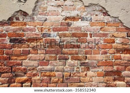 Old crumbling brick wall - stock photo