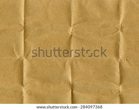 Old crumpled, recycled brown paper texture.