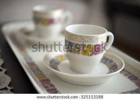 old cup of coffee in house of grandma - stock photo