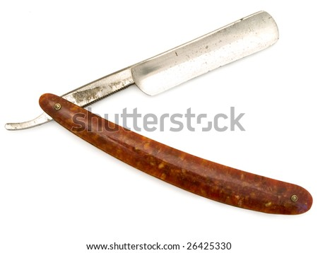 old cutthroat razor with open blade against white background