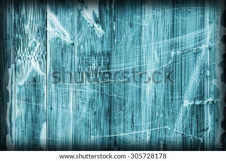 Old Cyan Stained Varnished Wooden Laminated Panel, Weathered, Cracked, Scratched Vignette Grunge Texture. - stock photo