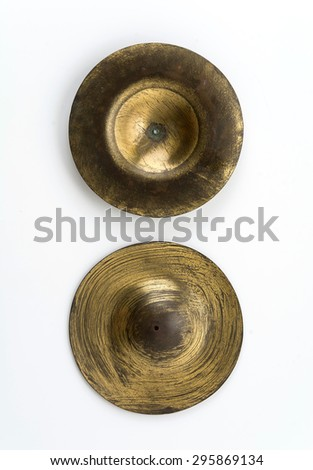 old cymbals on white background - stock photo