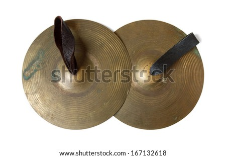 Old cymbals with leather handheld on white background, include path - stock photo