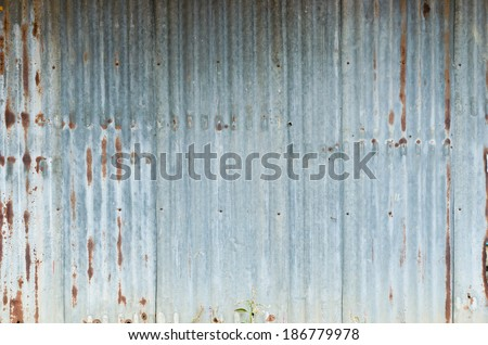 Old damage rusty zinc plat wall - stock photo