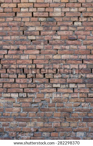 Old damaged brick wall - stock photo