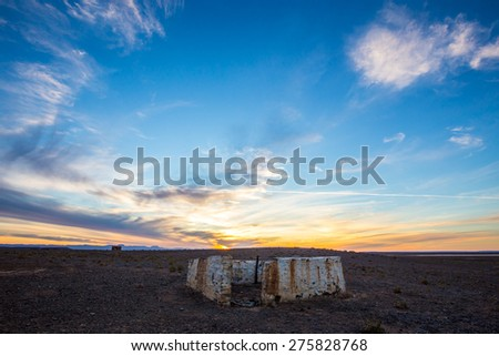 Old damaged buildings in arid karoo with beautiful cloudy sky - stock photo