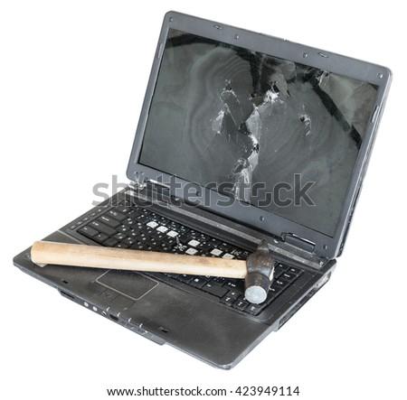 old damaged laptop with hammer on keyboard isolated on white background - stock photo