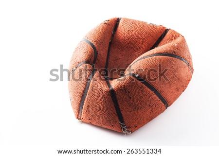 Old damaged rubber basket ball on background - stock photo