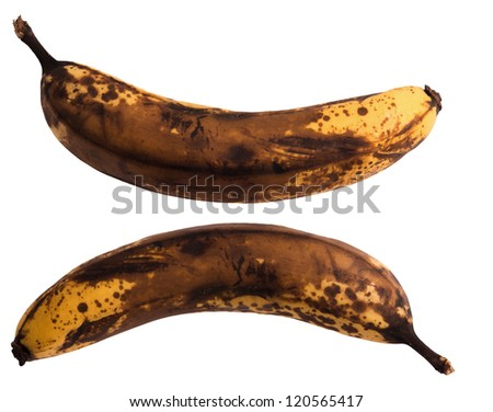Old dark brown banana isolated on background