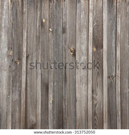 Old dark brown weathered wood fence texture - stock photo