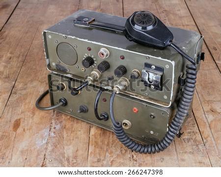 old dark green amateur ham radio on wooden table - stock photo