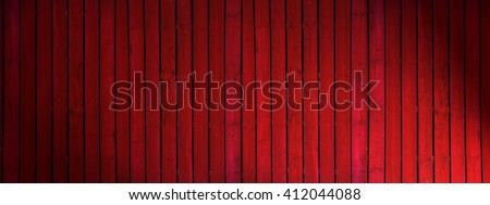 Old  dark red painted wooden wall  with spotlight- texture or background
