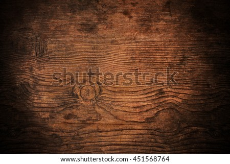 Old dark wood texture with grain, with vignette border - stock photo