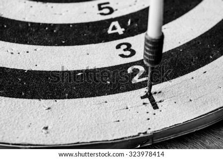 old dart target with arrows,abstract background to solution concept. - stock photo