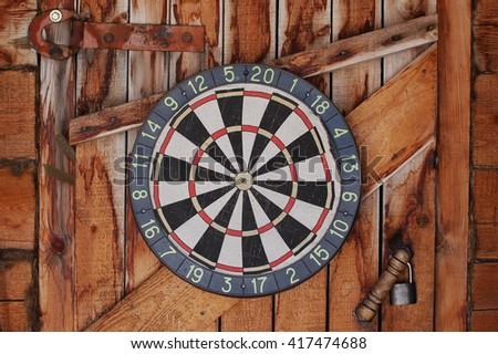 Old darts on a wooden wall