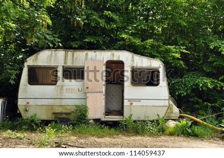 Old decayed and abandoned caravan