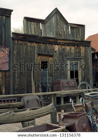Old decaying western merchant wooden building with windows - stock photo
