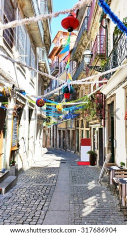 Old decorated street in Porto Portugal - stock photo