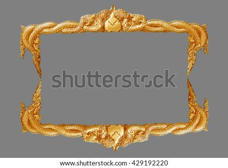 old decorative gold frame - handmade, engraved - isolated on gray background - stock photo