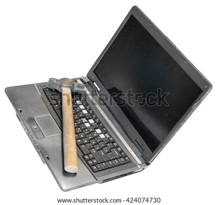 old defective laptop with hammer on keyboard isolated on white background - stock photo