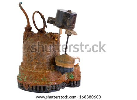 Old defunct obsolete grungy rusted sump pump that has been removed for replacement due to malfunction or breakdown, on white - stock photo