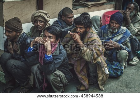 Old Delhi, Rajasthan India - February 15, 2016 : A shot of a group of hungry homeless people waiting in line to get some free food in the street of Old Delhi, Rajasthan India. - stock photo