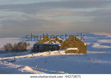 Old derelect house looks beautiful in the snow covered land of Northumberland - stock photo