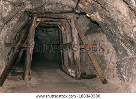 Old derelict mine. Tunnel entrance - stock photo
