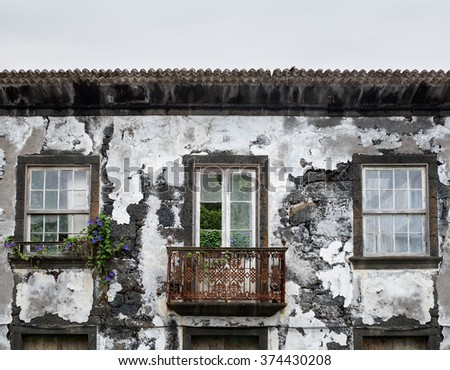 Old deserted house facade, abandoned old house  - stock photo