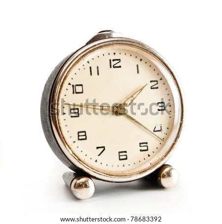 old desktop alarm clock isolated on white background - stock photo