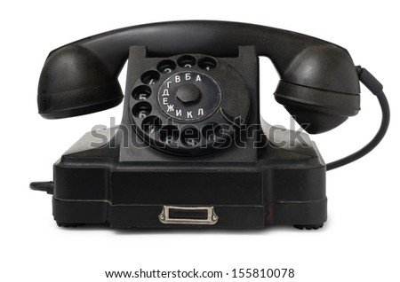 Old desktop telephone isolated on white background