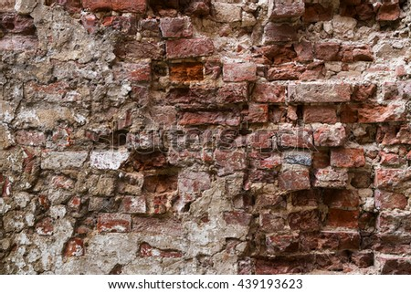 old destroyed brick wall as a background texture, copy space