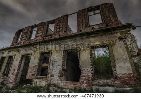 old destroyed house with bricks