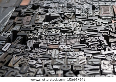 Old die press letters and numbers - stock photo